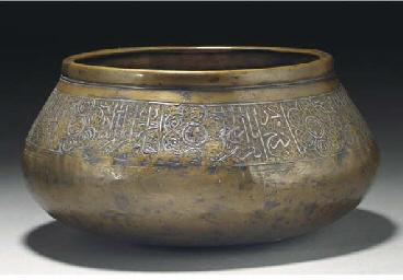 A Fars silver inlaid brass bow