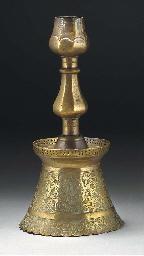 An Ottoman brass candlestick,