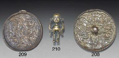 A cast bronze mirror, Eastern