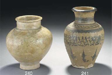 A Raqqa pottery vase, Syria, 1