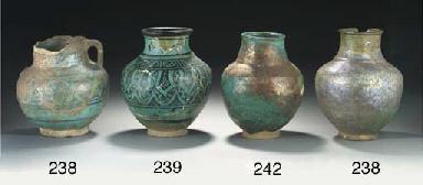 A turquoise glazed pottery vas