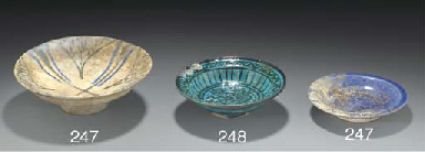 A pottery footed dish, Syria,