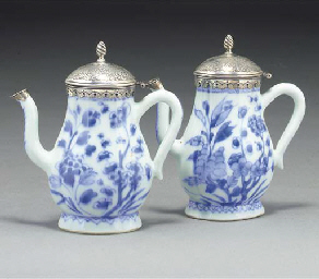 A pair of blue and white ewers