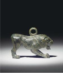 A GREEK BRONZE LION PENDANT