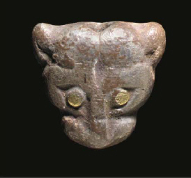 AN EGYPTIAN SILVER AMULET IN T