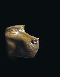 AN EGYPTIAN BRONZE HEAD OF A B