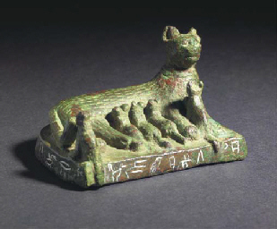 AN EGYPTIAN BRONZE CAT WITH FI
