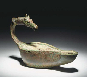 A ROMAN BRONZE LAMP WITH HORSE
