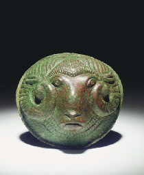 AN ETRUSCAN BRONZE BOSS IN THE