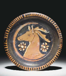 AN APULIAN RED-FIGURE PLATE WI