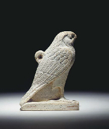 AN EGYPTIAN FRIT AMULET IN THE
