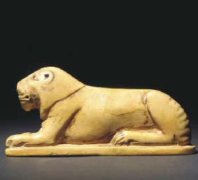 A HIPPOPOTOMUS-TOOTH IVORY FIG