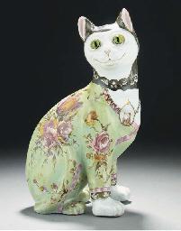 A POLYCHROME POTTERY CAT