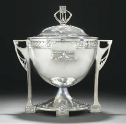A SILVERED METAL PUNCH BOWL