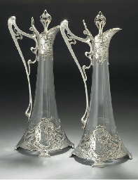 A PAIR OF SILVERED METAL AND C