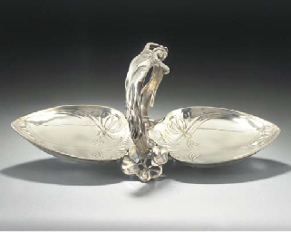 A SILVERED METAL DOUBLE TRAY