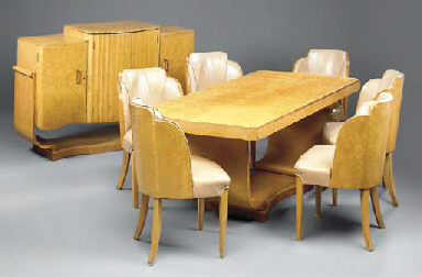 A BURR-MAPLE DINING SUITE