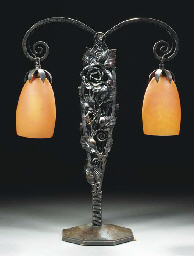 A WROUGHT IRON AND GLASS TWIN