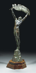 A PATINATED BRONZE FIGURE