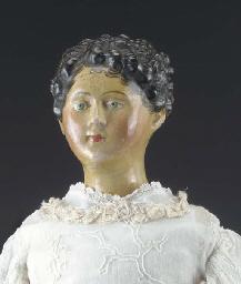 A papier-mache headed lady dol
