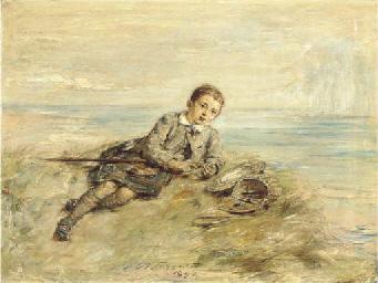 Boy by seashore