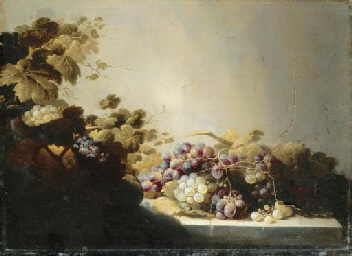 Grapes on a stone ledge with c