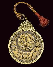 A decorative brass astrolabe,