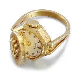 Rolex. An 18K gold ring watch