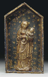 A CARVED GILTWOOD AND POLYCHRO