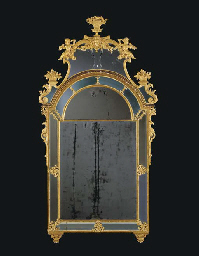 A SWEDISH GILTWOOD AND GILT-LEAD MIRROR