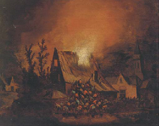 A village on fire at  night