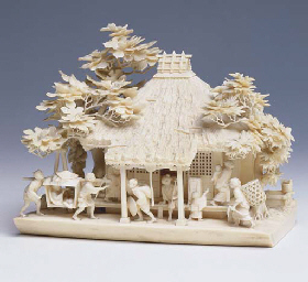 **A JAPANESE CARVED IVORY MODE