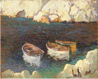 Three fishing boats moored in