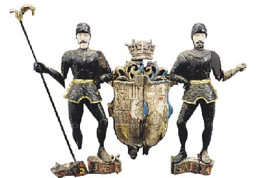 A carved oak Armorial coat-of-