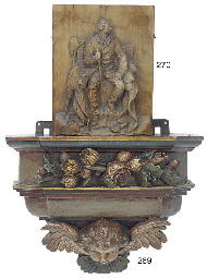 A polychrome carved wall brack