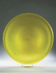 An Unica yellow glass dish