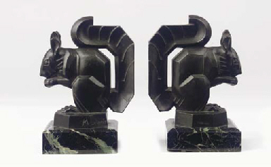 A pair of spelter bookrests