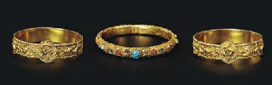 A PAIR OF GOLD BRACELETS; AND