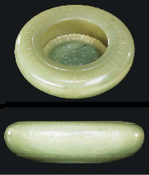AN UNUSUAL CELADON JADE BRUSH-