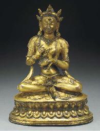 A Tibetan gilt-copper figure o
