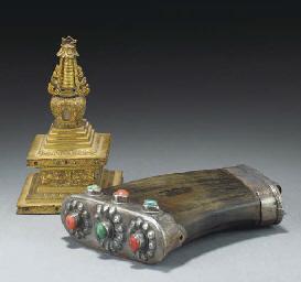 A Tibetan white metal mounted horn powder flask, 19th Century