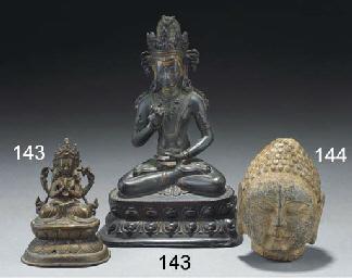 A Tibetan bronze model of a se
