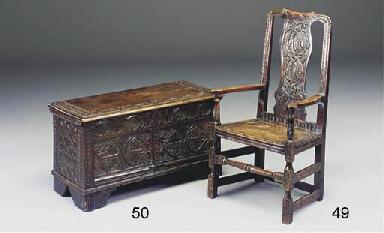 An carved oak armchair
