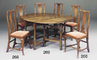 A LARGE MAHOGANY GATELEG TABLE