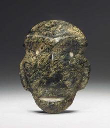 A MEZCALA STONE HEAD, TYPE M-2
