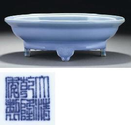 A lavender glazed oval vessel,