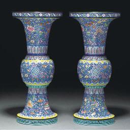 A pair of enamel gu vases, 18t