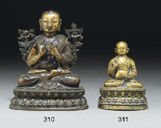 A Tibetan glit bronze model of