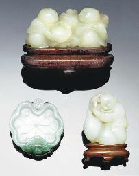 A pale celadon jade carved boy