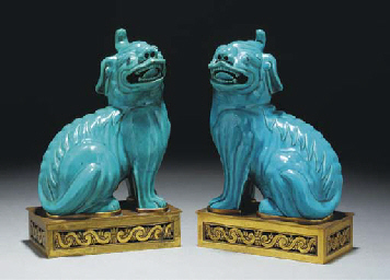 A pair of turquoise glazed kyl